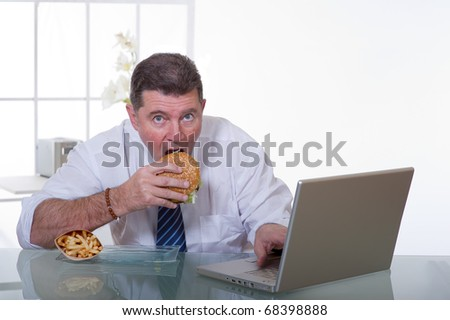 man at office  eat unhealthy fast food