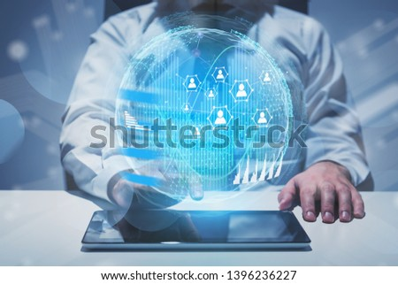 Man at office table using tablet computer with social connection hologram and infographics. Concept of people network in business and global world. Toned image double exposure #1396236227