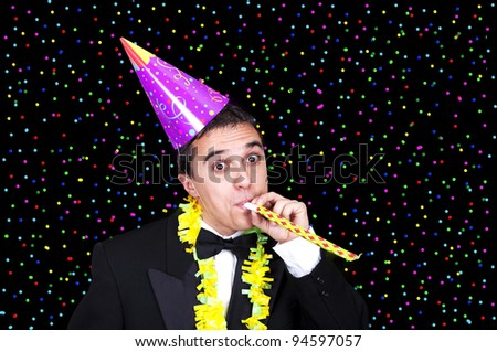 man at party under falling confetti