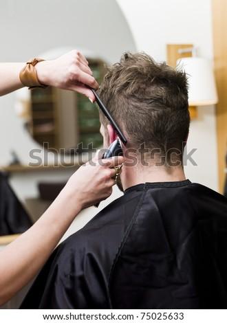 Man at the hair salon - stock photo