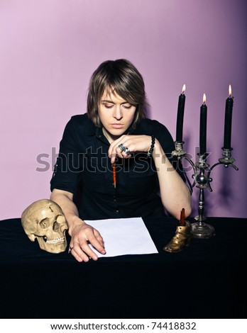 Man at the table with a candle and skull wrote a will