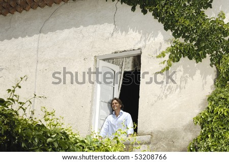 Man at the window - stock photo