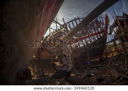 man at work building a boat