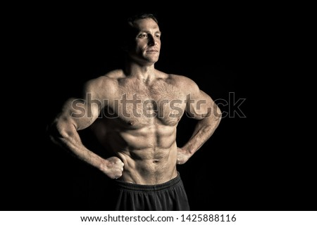 Man athlete with fit torso muscles. Bodybuilder with six pack and ab. Sportsman show biceps and triceps. Sport power and bodycare concept. Workout and training activity in gym, vintage.