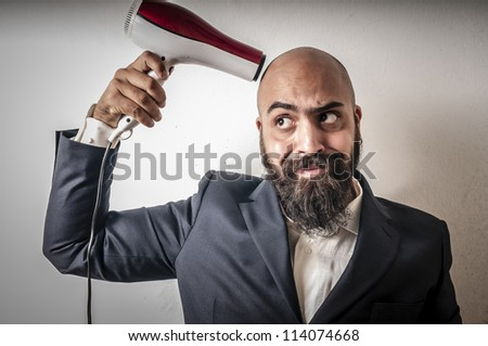 man bearded and jacket with hairdraier and funny expressions on white background