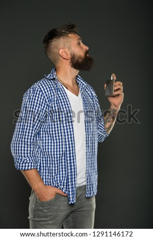 Man bearded handsome hold bottle perfume. Fragrance for brutal hipster. Fashion and beauty treatment. Masculine fragrance for brutal guy. Masculinity concept. Perfume male fragrance. Smell fragrance. #1291146172