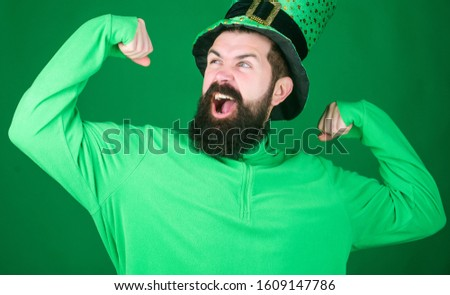 Man bearded hipster wear hat. Saint patricks day holiday. Green part of celebration. Happy patricks day. St patricks day holiday known for parades shamrocks and all things Irish. Global celebration.