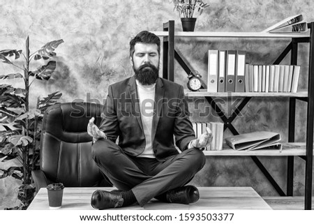 Man bearded manager sit lotus pose relaxing. Way to relax. Meditation yoga. Self care. Psychological help. Relaxation techniques. Mental wellbeing and relax.