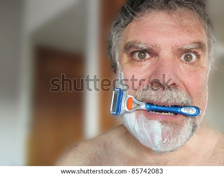 Man biting razor with the face of scare