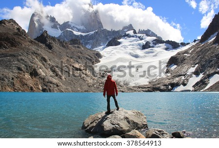 Man, blue lake, glacier and mountains. El Chalten (Argentina's Trekking Capital) - Patagonia