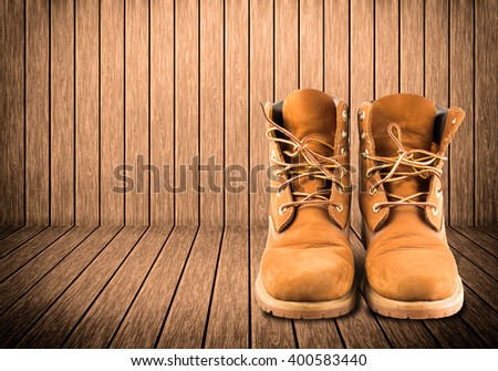 man boot adventure on wood texture background #400583440