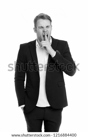 Man bored yawning white background. Fed up with this. Man dislike boring formal rules at workplace. Guy wears boring formal suit according to business dress code. Secret gesture. Do not tell someone.