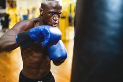 Man boxer training hard - Young black guy boxing in sport gym center club - Health fitness and sporty activity concept