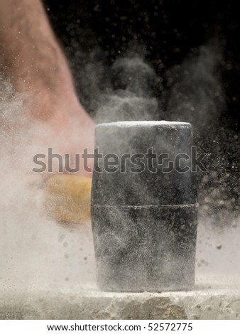 man breaking the stone, may be used as concept for power,strength,dest ruction,fury,anger, resistance...closeu p image with shallow DOF - stock photo