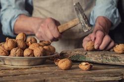 man breaks a hammer walnuts, kinfolk style