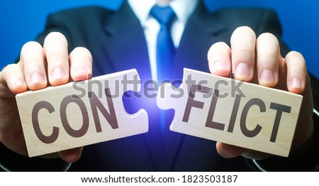 Man breaks puzzles with word Conflict. Resolution of disputes and conflicts in negotiations. Come to a general agreement. Stop confrontation. Mediator. Diplomacy and Geopolitics. Get along with others Photo stock ©
