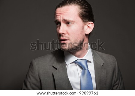 photo handsome young man with brown long hair and wearing