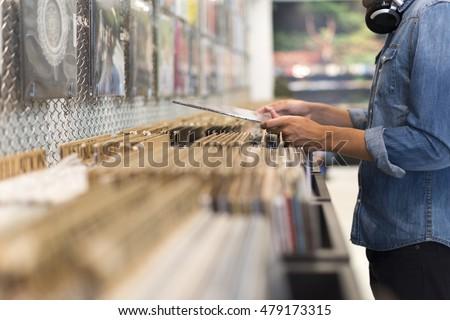Man browsing vinyl album in a record store