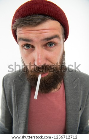 Man brutal bearded hipster smoking cigarette. Brutal habits and lifestyle. Hipster brutal bearded tobacco smoker. Brutality and masculinity. Brutal unshaven guy smoking white background close up.