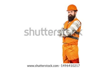 Man builders, industry. Worker in construction uniform. Architect builder. Bearded man worker with beard in building helmet or hard hat. Builder in hard hat, foreman or repairman in the helmet.