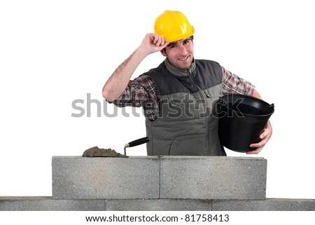 Man building stone wall