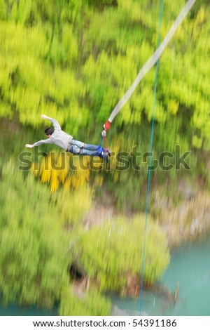 Man bungee jumping off Kawarau bridge in Queenstown New Zealand