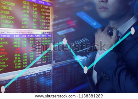 Man business graph charts of financial instruments with various type of indicators combine with gold and account book and money.Concept investment