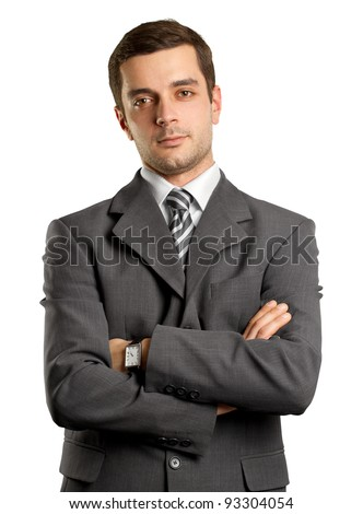 man businessman in suit, looking on camera, with folded hands