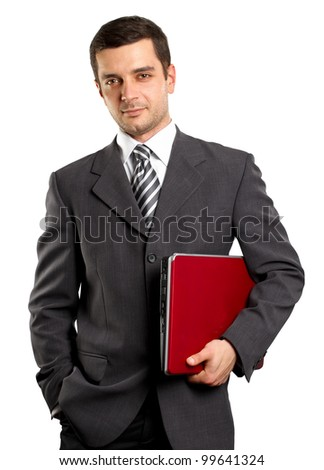 man businessman in suit with laptop in his hands, looking on camera