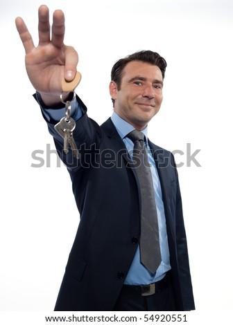 man businessman realtor handing keys studio on white background