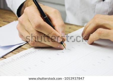 Man businessman signs documents #1053937847