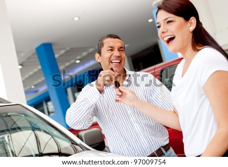 Man buying a car for his wife and handling her the keys