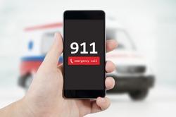 Man calling emergency. Ambulance in background. emergency call 911 aid man concept