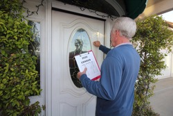 Man Canvassing a neighborhood for the 2020 census