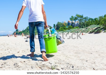 man carries food and drinks on the beach #1432576250