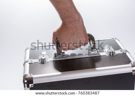 Man carries the aluminum metal suitcase, isolated on white background #760383487