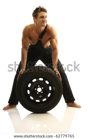 Man carries tires