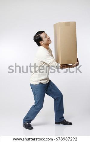 man carrying a box #678987292