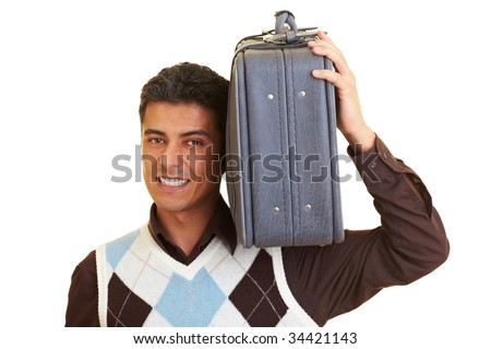 Man carrying a suitcase on his shoulder