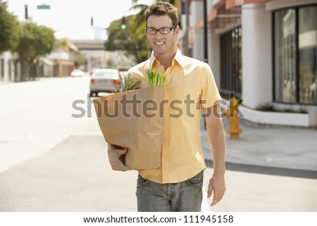 Man carrying a vegetable bag
