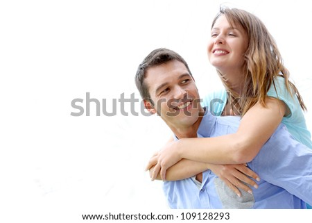 Man carrying girlfriend on his back, isolated