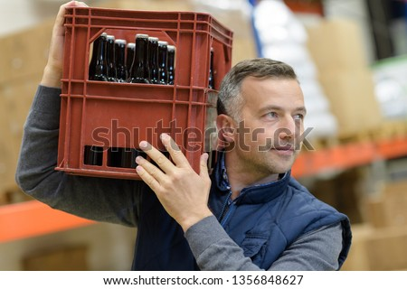 man carrying glass bottles of craft lager beer #1356848627