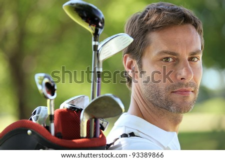 Man carrying golf bag