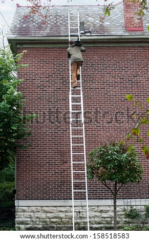 Man Carrying Slate up Ladder
