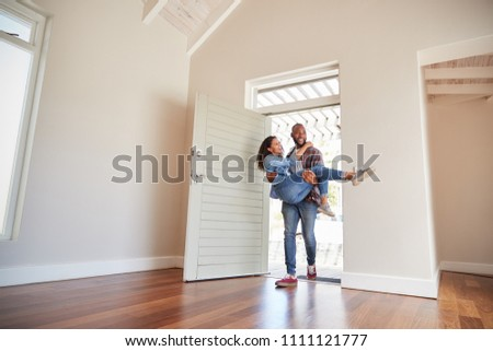 Man Carrying Woman Over Threshold Of Doorway In New Home #1111121777