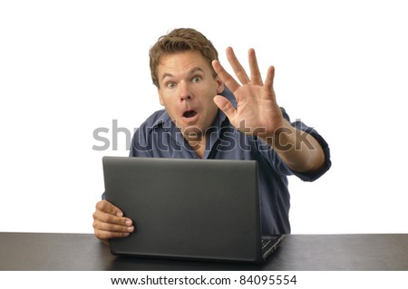 Man caught by surprise on computer raises hand to block view