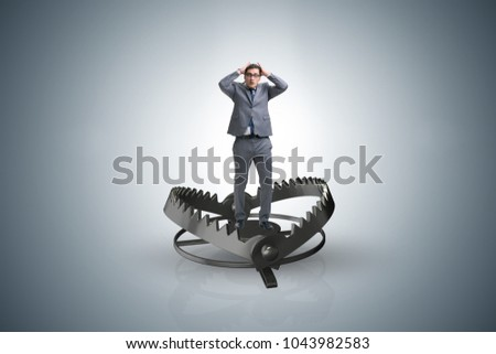 Man caught in mouse trap in risk business concept  #1043982583