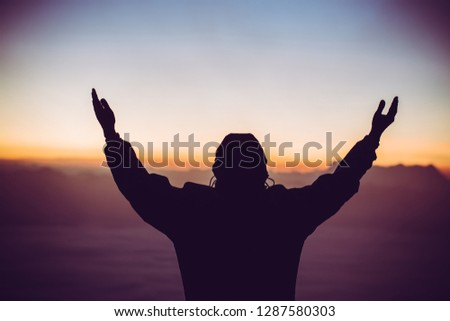 Man celebrating worship god in morning. Christian thought positive over sunset inspire praise for peace cross concept for freedom financial, vision and mission, self motivation, hope life love