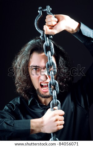 Man chained in the dark room