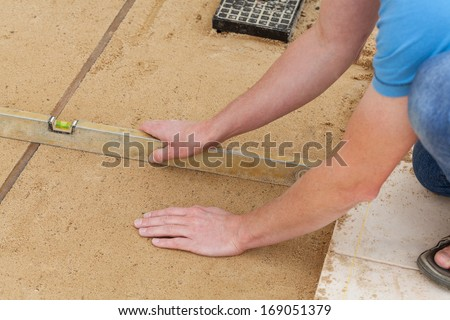 Man checking the ground level with level live #169051379